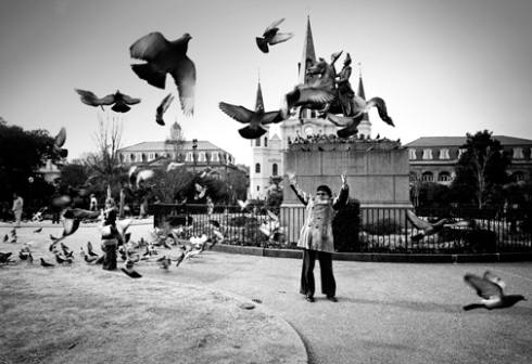 Tennessee Williams scaring the pigeons in Jackson Square New Orleans jpg