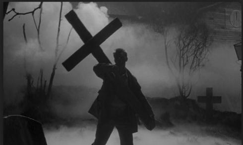 Bill Maitland brandishing the cross