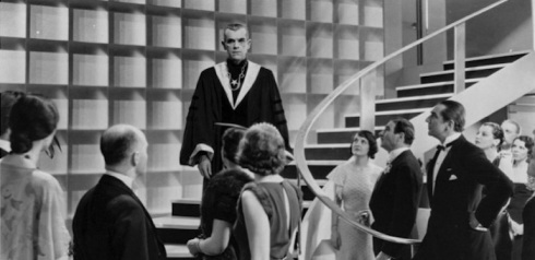 Cult group Karloff ascends the stairs