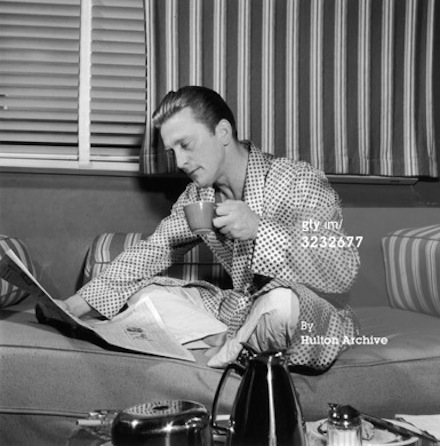Kirk Douglas drinking coffee