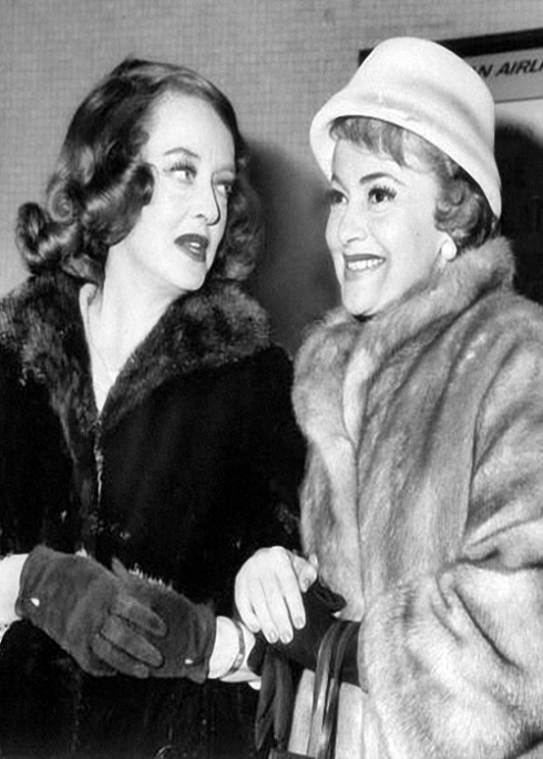 Betty Davis (left) and Olivia De Havilland arrive at Kennedy