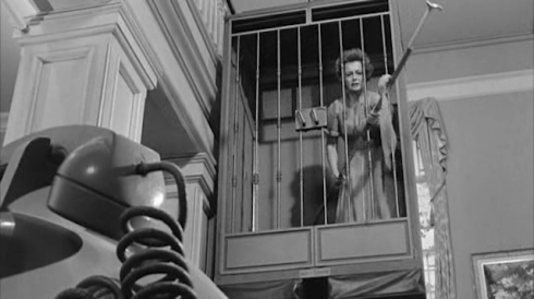 de Havilland in Lady in a Cage