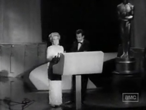 Joan accepts oscar for Anne Bancroft