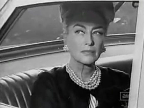 Joan close up in car on set of Hush