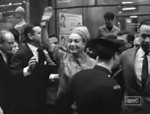 Joan greets crowd on set of Hush