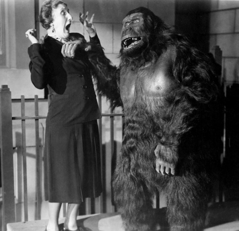 Woman screams at man in gorilla suit