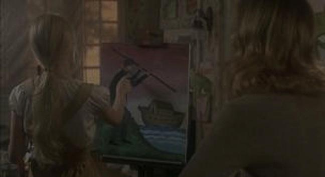 portrait of Aaron with his killer staff