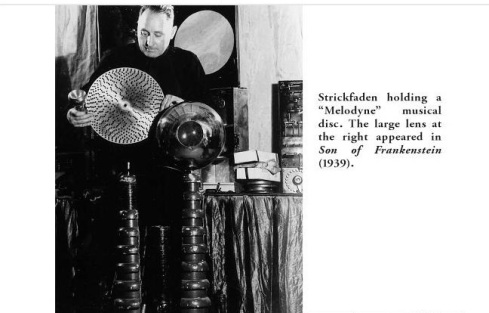 Strickfaden holding Melodyne musical disc The large lens appeared in Son of Frankenstain 1939