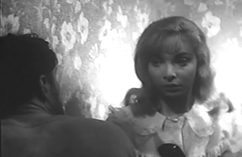 Arlene Martel in The Glass Cage tries to shake off the advances of King Moody