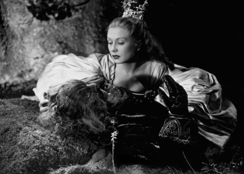 1946: French actress Josette Day (1914 - 1978) kneels over the stricken Beast, played by Jean Marais in Jean Cocteau's beautifully surreal film 'La Belle Et La Bete', based on the children's fairy tale 'Beauty and the Beast'. (Photo by Hulton Archive/Getty Images)