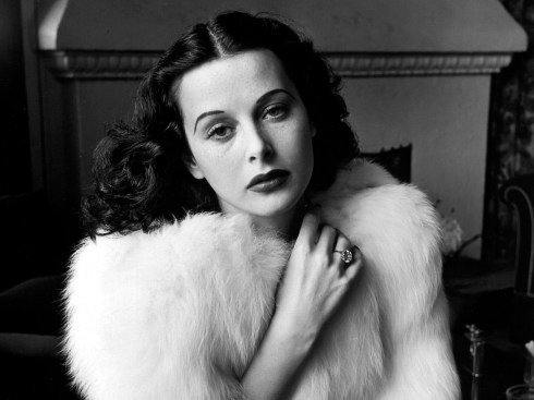 Glamorous portrait of movie actress Hedy Lamarr wearing white fox fur short jacket.1938