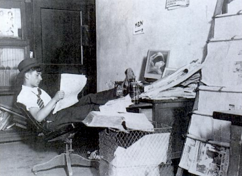 "1930 NYC ""Im a cocky crime reporter at the Graphic with a cluttered desk just around the corner from the men's room."
