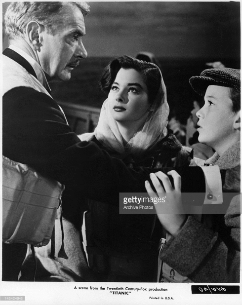 clifton-webb-reassuring-audrey-dalton-and-boy-in-a-scene-from-the-picture-id143424943